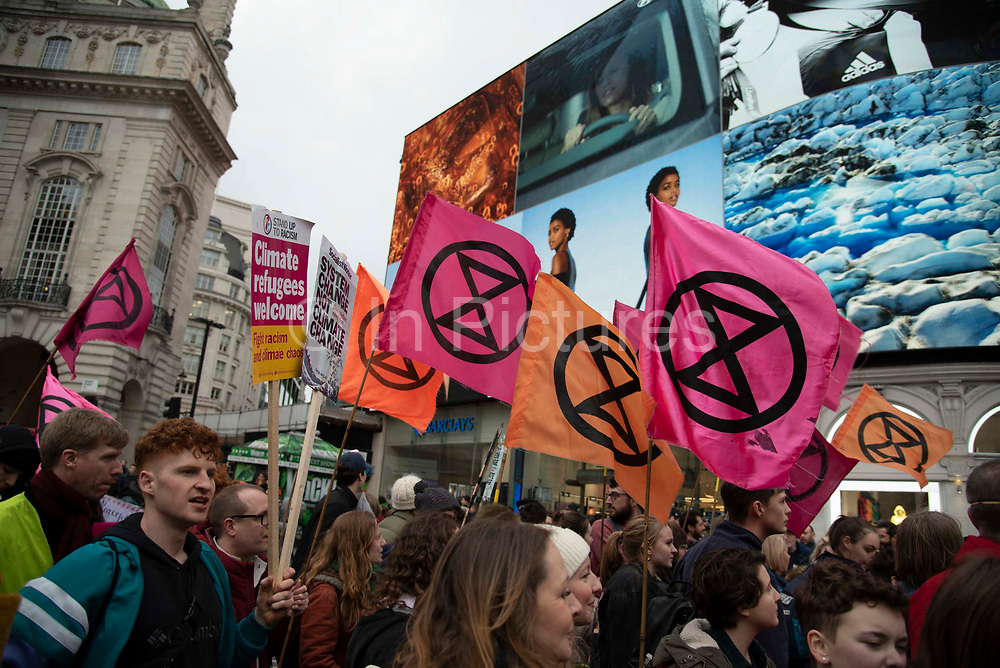 Climate change activists Extinction Rebellion march through Piccadilly to say 'Enough is Enough' to inaction on the climate and ecological emergency on 22nd February 2020 in Central London, United Kingdom. Extinction Rebellion is a climate change group started in 2018 and has gained a huge following of people committed to peaceful protests. These protests are highlighting that the government is not doing enough to avoid catastrophic climate change and to demand the government take radical action to save the planet.