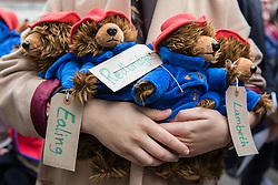 © Licensed to London News Pictures. 24/10/2016. London, UK. Paddington Bear toys with tags bearing the name of London councils that have agreed to take child refugees at a demonstration outside the Home Office to demand that the government move children from the Calais 'Jungle' camp in France to the United Kingdom. French authorities have begun the demolition of the camp. Photo credit: Rob Pinney/LNP