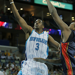 05 October 2008:  New Orleans Hornets guard Chris Paul (3) shoots a lay up past Golden State Warriors center Ronny Turiaf (21) during a NBA preseason home opener between the Golden State Warriors and the New Orleans Hornets at at the New Orleans Arena in New Orleans, LA..