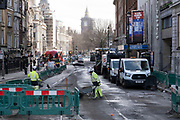With very few people out and about workmen conduct road works along Whitehall in Westminster as the national coronavirus lockdown three continues on 28th January 2021 in London, United Kingdom. Following the surge in cases over the Winter including a new UK variant of Covid-19, this nationwide lockdown advises all citizens to follow the message to stay at home, protect the NHS and save lives.