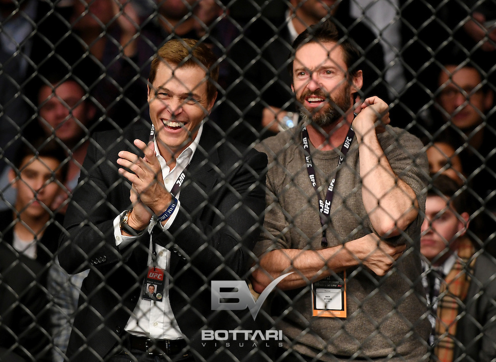 NEW YORK, NY - NOVEMBER 12: Actor Hugh Jackman (R) watches as Stephen Thompson and Tyron Woodley fight in their welterweight championship bout during the UFC 205 event at Madison Square Garden on November 12, 2016 in New York City.  (Photo by Jeff Bottari/Zuffa LLC/Zuffa LLC via Getty Images)