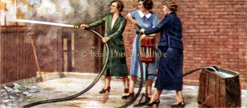 Air Raid Precautions': Set of 50 cards issued by WD & H0 Wills, Britain 1938, in preparation for the anticipated coming of World War II. Women fire-fighting with two-person manual fire pump.