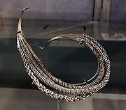 Likely made in Britain, and crafted from silver, gold and iron, this Viking-style neck ring was discovered in the Bedale Hoard which was buried AD 875-910 in North Yorkshire. See this and other important finds at the Yorkshire Museum, York, England, United Kingdom, Europe. Founded by the Romans under the name Eboracum in 71 AD, York became capital of the Roman province of Britannia Inferior, and later of the kingdoms of Northumbria and Jorvik, which was mostly controlled by Vikings 875 to 954. In the Middle Ages, York grew as a major wool trading centre and became the capital of the northern ecclesiastical province of the Church of England, to this day. In the 1800s, York became a hub of the railway network and center for confectionery manufacturing. The University of York, health services, and tourism have become major employers.