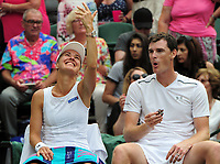 Tennis - 2017 Wimbledon Championships - Week Two, Sunday [Day Thirteen]<br /> <br /> Mixed Doubles Final match<br /> <br /> Jamie Murray (GBR) and Martina Hingis (SUI) vs Henri Kontinen (FIN) and Heather Watson (GBR)<br /> <br /> Jamie Murray and Martina Hingis reflect after winning the match on  Centre court <br /> <br /> COLORSPORT/ANDREW COWIE