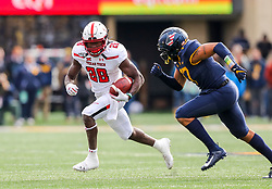 Nov 9, 2019; Morgantown, WV, USA; Texas Tech Red Raiders running back SaRodorick Thompson (28) runs the ball while chased by West Virginia Mountaineers linebacker Exree Loe (17) during the second quarter at Mountaineer Field at Milan Puskar Stadium. Mandatory Credit: Ben Queen-USA TODAY Sports