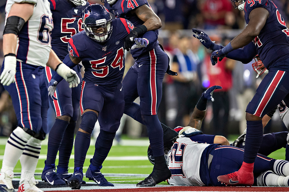 HOUSTON, TX - DECEMBER 1:  Jacob Martin #54 of the Houston Texans celebrates after sacking Tom Brady #12 of the New England Patriots during the first half at NRG Stadium on December 1, 2019 in Houston, Texas.  The Texans defeated the Patriots 28-22.  (Photo by Wesley Hitt/Getty Images) *** Local Caption *** Jacob Martin; Tom Brady