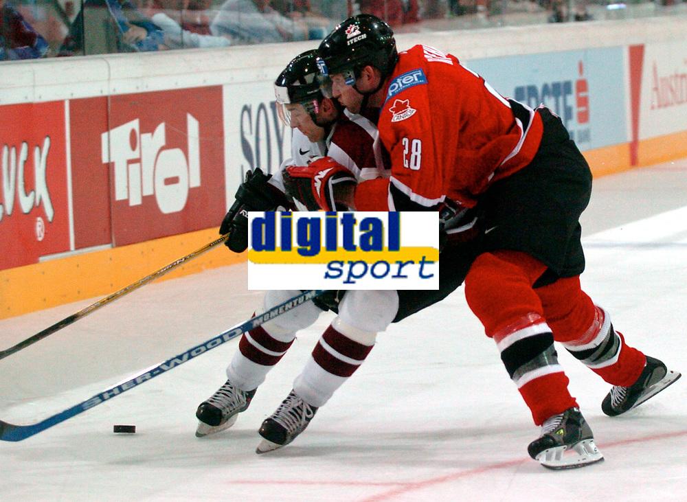 ◊Copyright:<br />GEPA pictures<br />◊Photographer:<br />Andreas Troester<br />◊Name:<br />Sirokovs<br />◊Rubric:<br />Sport<br />◊Type:<br />Eishockey<br />◊Event:<br />IIHF Eishockey WM 2005, Lettland vs Kanada, LAT vs CAN<br />◊Site:<br />Innsbruck, Austria<br />◊Date:<br />30/04/05<br />◊Description:<br />Aleksejs Sirokovs (LAT), Robyn Regehr (CAN)<br />◊Archive:<br />DCSTR-3004051837<br />◊RegDate:<br />30.04.2005<br />◊Note:<br />8 MB - BG/BK - Nutzungshinweis: Es gelten unsere Allgemeinen Geschaeftsbedingungen (AGB) bzw. Sondervereinbarungen in schriftlicher Form. Die AGB finden Sie auf www.GEPA-pictures.com. Use of pictures only according to written agreements or to our business terms as shown on our website www.GEPA-pictures.com
