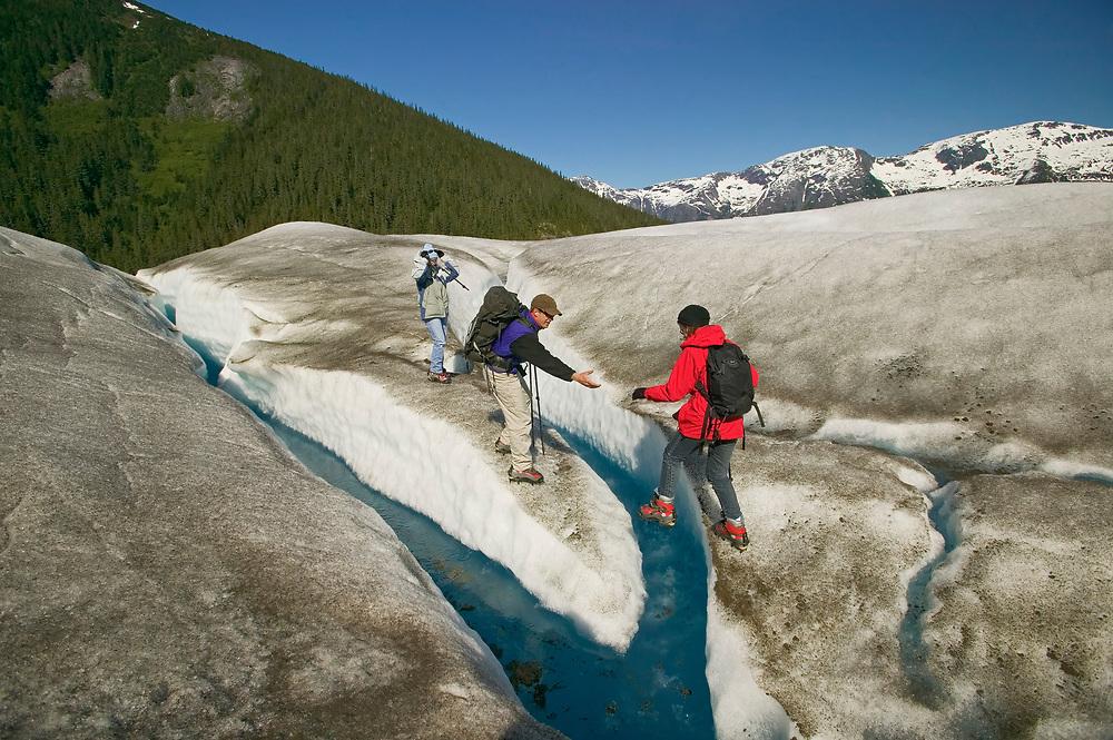 USA, Alaska, Inside Passage, Juneau, Tongass National Forest, Taku Glacier, Glacier Heli-Walk (model released)