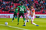 Ben Whiteman of Doncaster Rovers (8) tackles Bright Enobakhare of Coventry City (24) during the EFL Sky Bet League 1 match between Doncaster Rovers and Coventry City at the Keepmoat Stadium, Doncaster, England on 4 May 2019.