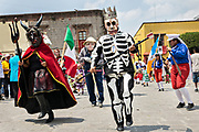 The skeleton king leads a procession of costumed dancers through the Jardin Allende during a children's parade celebrating Mexican Independence Day celebrations September 17, 2017 in San Miguel de Allende, Mexico.