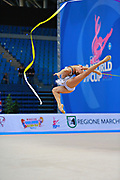 "Kudryavtseva Yana of Russia  during qualifying at ribbon in Pesaro World Cup at Adriatic Arena on  April 12, 2015, Italy. Yana ""The Queen"" is a Russian gymnast born in Moscow on September30, 1997. Until her retirement in 2017 was one of atllete most awarded in the history of rhythmic gymnastics."