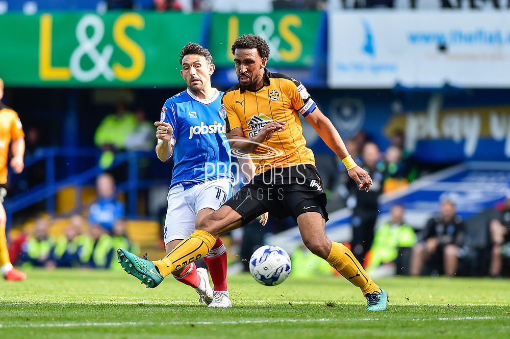 Portsmouth Midfielder, Gary Roberts (11) and Cambridge United Defender, Leon Legge (6) during the EFL Sky Bet League 2 match between Portsmouth and Cambridge United at Fratton Park, Portsmouth, England on 22 April 2017. Photo by Adam Rivers.