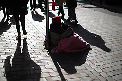 © Licensed to London News Pictures . 24/10/2018. Leeds , UK . DEBBIE SEWELL (50) , who is homeless , sitting on the pavement on Albion Street with her dog MISSY . At least six people sleeping rough have died in the Metropolitan Borough of the City of Leeds since March 2017 and West Yorkshire Police say they responded to 66 reported cases of people suffering the effects of Spice in July 2018 , a large increase on previous months . Photo credit : Joel Goodman/LNP