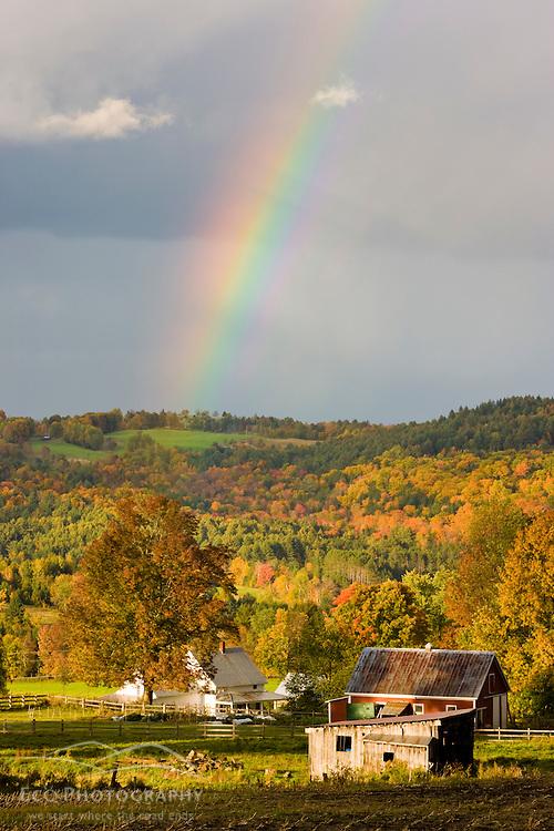 A rainbow over farms in Peacham, Vermont. Fall.