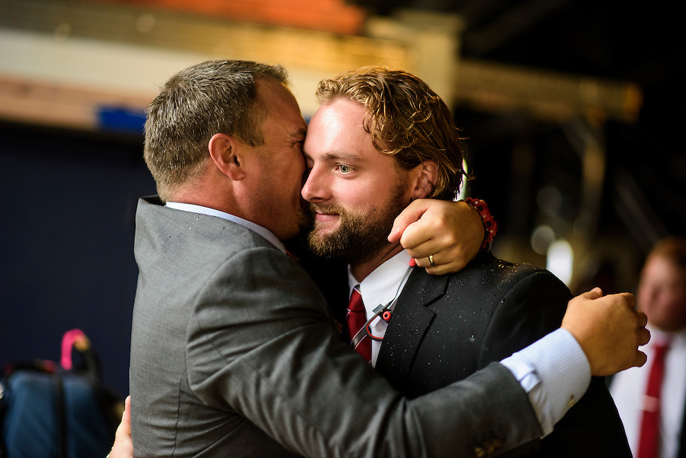 Annapolis, Maryland - October 08, 2016: Tom Herman, the University of Houston's head coach, hugs and kisses  Tyler McCloskey senior tight end before their game against Navy, in Annapolis, Md., Saturday October 8, 2016.<br /> <br /> <br /> Before every game, Tom Herman, the University of Houston's head coach, hugs and kisses each of his players during the walk from the bus to the locker room .<br /> <br /> The Cougars lost their first game of the season to the Midshipmen 40 - 46.<br /> <br /> <br /> CREDIT: Matt Roth for The New York Times<br /> Assignment ID:  30196504A