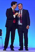 © Licensed to London News Pictures. 01/10/2012. Manchester, UK Shadow Chancellor Ed Balls (right) is congratulated by Leader Ed Miliband as he makes his conference speech on Rebuilding the Economy. Labour Party Conference Day 2 at Manchester Central. Photo credit : Stephen Simpson/LNP