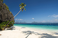 A perfect, secluded white sand beach found on an island just off shore from El Nido Town, Palawan, The Philippines.