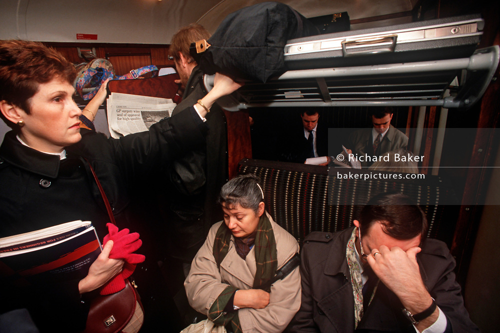 1990s passengers sit and stand in an overcrowded train carriage in the City of London (aka The Square Mile), the capital's financial centre, on 18th February 1992, in London, England. (Photo by Richard Baker / In Pictures via Getty Images)