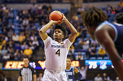 Dec 1, 2019; Morgantown, WV, USA; West Virginia Mountaineers guard Miles McBride (4) shoots a foul shot during the second half against the Rhode Island Rams at WVU Coliseum. Mandatory Credit: Ben Queen-USA TODAY Sports