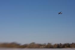A Military Transport Plane Flying over Lake Nokomis