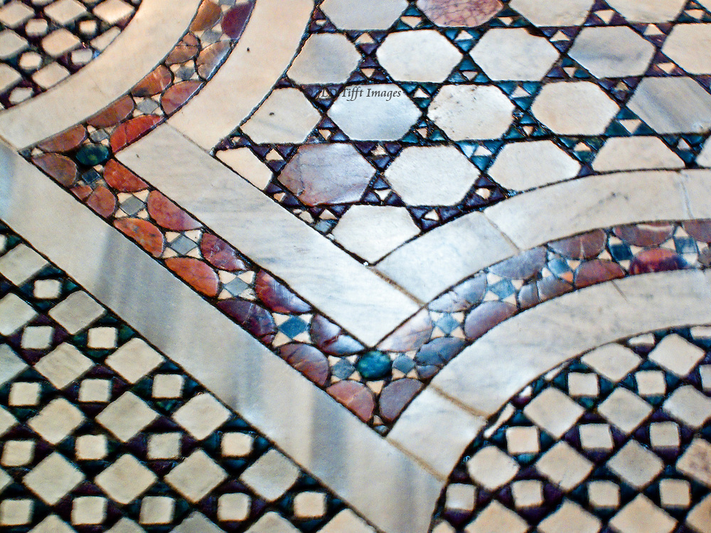 Santa Pudenziana, nave; Cosmati floor; detail of the geometric design of lozenges, stripes, polygons, in cream, grey, red, and blue marble.