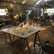 Mallaig Boatyard. Ian MacLeod, fabricator welder cutting steel. Picture Robert Perry 9th April 2016<br /> <br /> Must credit photo to Robert Perry<br /> FEE PAYABLE FOR REPRO USE<br /> FEE PAYABLE FOR ALL INTERNET USE<br /> www.robertperry.co.uk<br /> NB -This image is not to be distributed without the prior consent of the copyright holder.<br /> in using this image you agree to abide by terms and conditions as stated in this caption.<br /> All monies payable to Robert Perry<br /> <br /> (PLEASE DO NOT REMOVE THIS CAPTION)<br /> This image is intended for Editorial use (e.g. news). Any commercial or promotional use requires additional clearance. <br /> Copyright 2014 All rights protected.<br /> first use only<br /> contact details<br /> Robert Perry     <br /> 07702 631 477<br /> robertperryphotos@gmail.com<br /> no internet usage without prior consent.         <br /> Robert Perry reserves the right to pursue unauthorised use of this image . If you violate my intellectual property you may be liable for  damages, loss of income, and profits you derive from the use of this image.