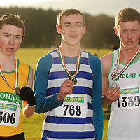 11 December 2011; Ryan Holt, Ulster, winner, with second placed Ian Hartnett, Togher AC, right, and third placed Jake O'Regan, St. Johns AC, Clare, left, after the Boy's U19 race at the Woodie's DIY Novice and Juvenile Cross Country Championships. Curragh Camp, The Curragh, Co. Kildare. Picture credit: Pat Murphy / SPORTSFILE *** NO REPRODUCTION FEE ***