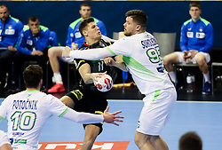 Sebastian Heymann of Germany vs Matic Suholeznik of Slovenia during handball match between National Teams of Germany and Slovenia at Day 2 of IHF Men's Tokyo Olympic  Qualification tournament, on March 13, 2021 in Max-Schmeling-Halle, Berlin, Germany. Photo by Vid Ponikvar / Sportida