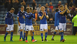 Dejected Carlisle players applaud their fans after being beaten 2-1 by Sunderland