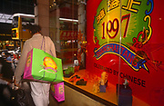 A shopper leaves the Shanghai Tang fashion store in Central, the day after the Handover of sovereignty from Britain to China, on 30th June 1997, in Hong Kong, China. Midnight signified the end of British rule, and the transfer of legal and financial authority back to China. Hong Kong was once known as fragrant harbour or Heung Keung because of the smell of transported sandal wood.