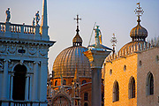 View of St. Mark's Basilica rooftop domes and Saint Theodore statue, patron of Venice, from the Piazzetta, Venice, Italy