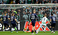 19/08/15 UEFA CHAMPIONS LEAGUE PLAY-OFF 1ST LEG<br /> CELTIC V MALMO<br /> CELTIC PARK - GLASGOW<br /> Leigh Griffiths slots the ball by Malmo keeper Johan Wiland to open the scoring for Celtic.