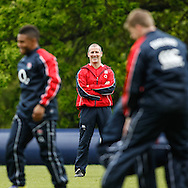 Picture by Andrew Tobin/Tobinators Ltd +44 7710 761829.24/05/2013.England head coach Stuart Lancaster laughs during the England training session at Pennyhill Park, Bagshot ahead of the match against the Barbarians on 26th May 2013.