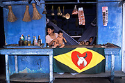 "A street vendor supporter of the "" Caprichoso"" bull Amazon carnival team, Parintins, Brazil."