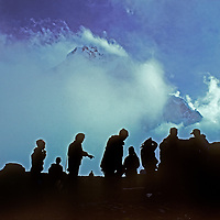 Sherpas and porters set up a camp for trekkers at Dzongla Meadows, under the North Face of Cholatse, a peak near Mount Everest in Nepal.