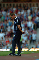 Photo: Tony Oudot.<br /> West Ham United v Wigan Athletic. The FA Barclays Premiership. 25/08/2007.<br /> West Ham manager Alan Curbishley looks down as his team puts in a terrible first half display