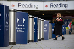 Barriers and Covid-19 signage at Reading train station. UK September 2020