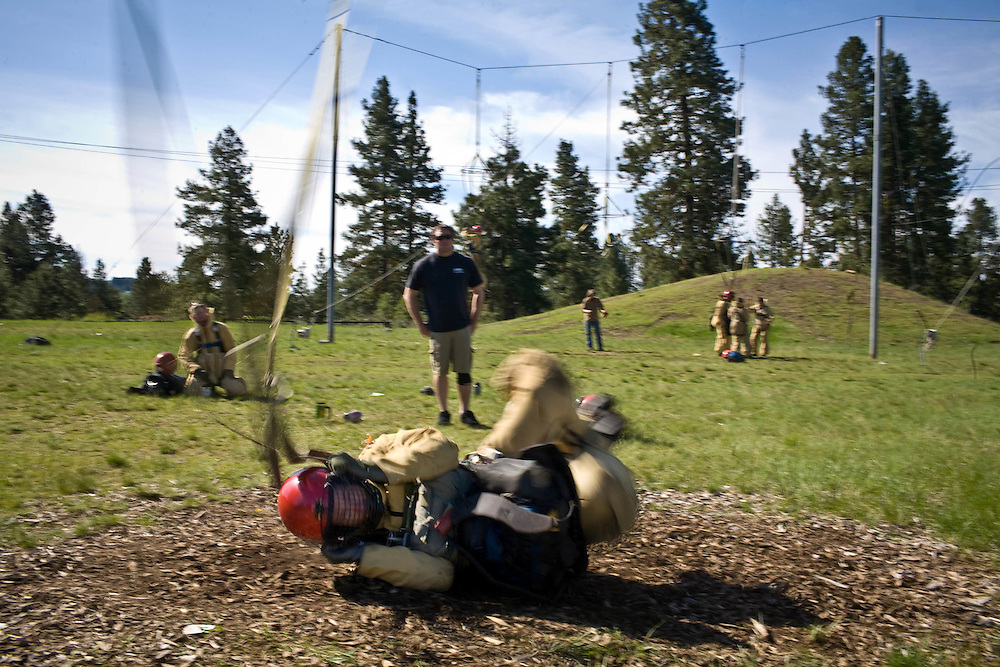 A smokejumper is dropped from 'The Mutilator', a mechanized pulley system that pulls trainees at the McCall smokejumper base approximately 35 feet in the air, only to drop them at speeds up to 15 miles per hour. The system is designed to help smokejumper learn how to land in rough conditions during fire season.