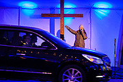 22 DECEMBER 2020 - WEST DES MOINES, IOWA: A minister preaches during the drive through tent revival at the Lutheran Church of Hope's drive through Christmas experience. About 3,000 cars per night going through the drive through Christmas pageant at Lutheran Church of Hope in West Des Moines. The church staged the drive through Christmas pageant because they decided it wasn't safe to hold in person Christmas services or pageant during the COVID-19 pandemic. On Tuesday night people started lining up to get into the pageant almost an hour before it started.     PHOTO BY JACK KURTZ