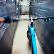 Jay Goodrich coasts his bike down the hall of lockers at Steven's Pass Resort near Leavenworth, Washington.