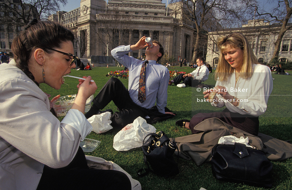 Three nineties City workers enjoy their lunchtime with takeaway salad and a sandwich in Trinity Park in the City of London, on 22nd June 1993, in London, England.
