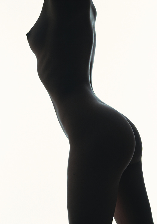 Torso of nude woman in silhouette against a white background