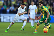 Angel Rangel of Swansea city  (l) looks to go past Timm Klose of Norwich city.  Barclays Premier league match, Swansea city v Norwich city at the Liberty Stadium in Swansea, South Wales  on Saturday 5th March 2016.<br /> pic by  Andrew Orchard, Andrew Orchard sports photography.