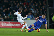 Robert Huth of Leicester city goes in two footed to foul Tom Carroll of Swansea city ® and gets a yellow card off the referee . Premier league match, Swansea city v Leicester City at the Liberty Stadium in Swansea, South Wales on Sunday 12th February 2017.<br /> pic by Andrew Orchard, Andrew Orchard sports photography.