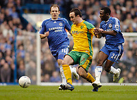 Photo: Leigh Quinnell.<br /> Chelsea v Norwich City. The FA Cup. 17/02/2007.<br /> Norwichs' Lee Croft fights off Chelseas Shaun Wright-Phillips(R) and Arjen Robben.