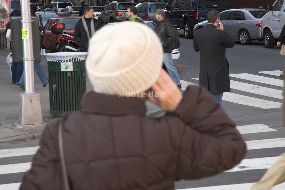 pedestrians in New York City on there cell phones