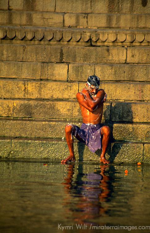 Asia, India, Varanasi. Man bathes in the sacred Ganges River.