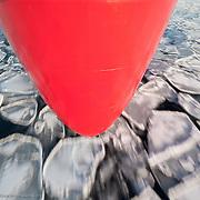 The hull of the icebreaker Polar Sea passes through thin layers of pancake ice in the Chukchi Sea.