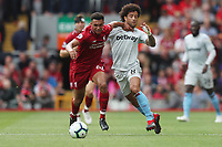 Football - 2018 / 2019 Premier League - Liverpool vs. West Ham United<br /> <br /> Trent Alexander-Arnold of Liverpool catches Felipe Anderson of West Ham United in the throat and receives a yellow card at Anfield.<br /> <br /> COLORSPORT