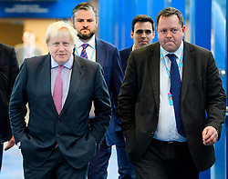 © Licensed to London News Pictures. 03/10/2016. Birmingham, UK. British foreign Secretary BORIS JOHNSON (left) seen with his aide WILL WALDEN (right) at day two of the 2016 Conservative Party Conference. Walden, who followed Boris Johnson from City Hall, will no longer be working under the foreign sec after Downing Street refused to sign off on the appointment. Photo credit: Ben Cawthra/LNP